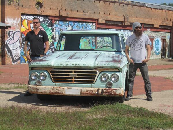 Bild 1 von 3: Richard Rawlings and Aaron Kauffman pose next to a 1964 Dodge pickup truck.