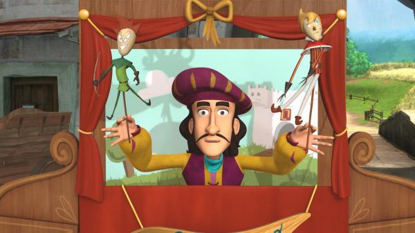 Bild 1 von 4: Der Puppenspieler Manolo Bacco bereitet sich auf seinen Auftritt vor.