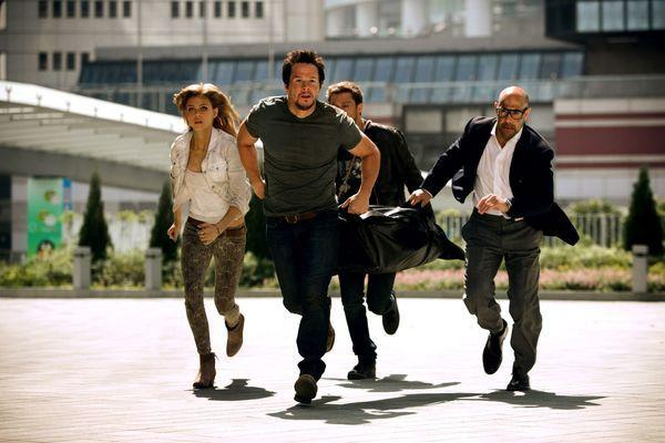 Bild 1 von 3: Left to right: Nicola Peltz plays Tessa Yeager, Mark Wahlberg plays Cade Yeager, Jack Reynor plays Shane Dyson and Stanley Tucci plays Joshua Joyce in TRANSFORMERS: AGE OF EXTINCTION, from Paramount Pictures.
