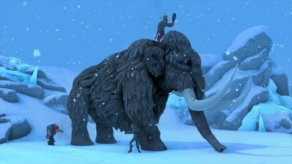 Bild 1 von 3: Die Avatare von Meg (Alexa Davies, l.), Usman (Sargon Yelda, r.) und Nicky (Will Merrick, 2.v.r.) greifen ein Mammut an.