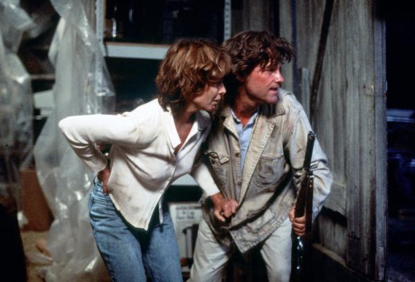 Bild 1 von 3: Schafft Jeffrey (Kurt Russell) es, seine Frau Amy (Kathleen Quinlan) aus den Fängen der kaltblütigen Entführer zu befreien und in Sicherheit zu bringen?