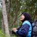 Thailand - Die junge Frau und die Nashornvögel