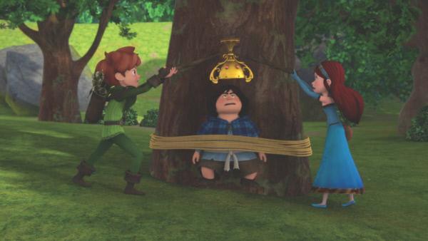Bild 1 von 5: Nur mit Mühe gelingt es Robin (l.) und Marian (r.), Tuck (M.) den verhexten Pokal abzunehmen.