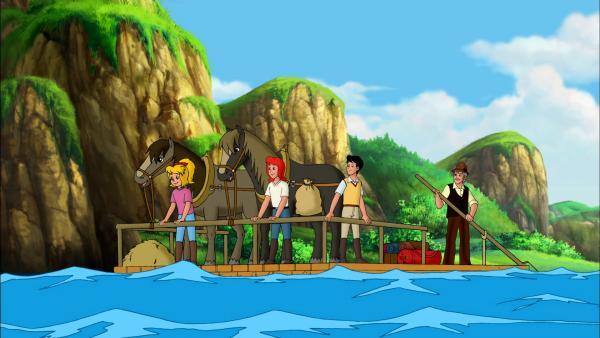 Bild 1 von 6: Mit dem Floß müssen Bibi (l.), Tina (M.) und Alex (2.v.r.) den Fluss überqueren, um zu der Kupfermine des Grafen zu gelangen.