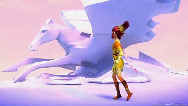 Bild 1 von 3: Die Eisstatue eines geflügelten Einhorns weist Mia und ihren Freunden den Weg zu einer geheimnisvollen Insel, zu der sie als nächstes fliegen müssen.